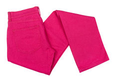 Bright pink jeans folded Stock Photos