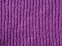 Bright pink lilac wool hand knitted texture abstract background Stock Image