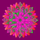 Bright pink mandala on the purple background. Stock Photography
