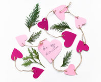 Bright pink paper hearts connected with a rope for Valentine`s day. Flat lay on white background Stock Photos