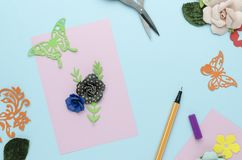 Bright pink postcard with paper flowers. On blue background royalty free stock photos
