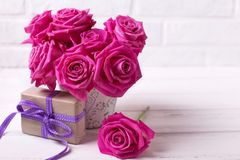 Bright pink roses flowers in pot Stock Photo