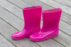 Bright pink rubber boots Stock Photos