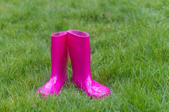 Bright pink rubber boots Royalty Free Stock Photos