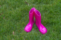 Bright pink rubber boots Stock Photo