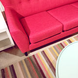 Bright pink sofa and coffee table Royalty Free Stock Photo
