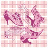 Bright pink vintage women`s shoes. On a checkered background Royalty Free Stock Image