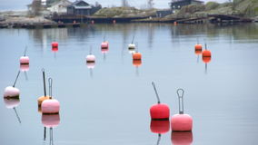 Bright plastic buoys in lead-gray water of the Baltic Sea. Late fall on the coast. stock footage