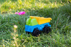 Bright plastic car in grass Royalty Free Stock Image