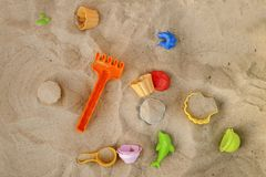 Bright plastic children`s toy in the sand. Children`s toys for t royalty free stock photos