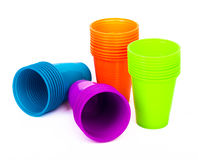 Bright plastic cups isolated on white  Royalty Free Stock Photos