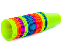 Bright plastic cups rolling stacked on white background Royalty Free Stock Images