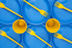 Bright plastic disposable tableware, background Royalty Free Stock Photo