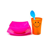 Bright plastic disposable tableware isolated Royalty Free Stock Photo