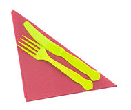 Bright plastic knife and fork on red serviette, napkin. Stock Images