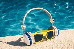 Bright Plastic Sunglasses and Headphones. Hipster Set - Bright Plastic Sunglasses and Headphones stock photos