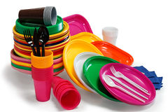 Bright Plastic tableware isolated on the white. Background Royalty Free Stock Photography