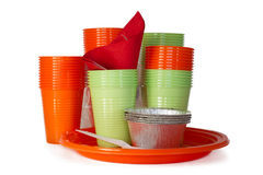 Bright plastic tableware isolated on white Royalty Free Stock Images