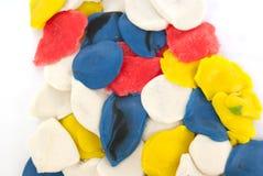 Bright plasticine. Bright multicolored pieces of plasticine in white Stock Photography