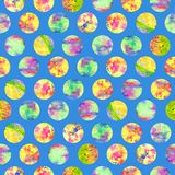 Bright polka dot abstract grunge colorful splashes texture watercolor seamless pattern design in yellow. Green, pink colors palette on soft blue background Stock Image