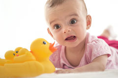 Bright portrait of adorable baby on white. Bright portrait of adorable baby girl on white Stock Photography