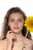 Bright portrait of beautiful girl with perfect clean skin. With sunflower in her hand isolated on white Royalty Free Stock Images