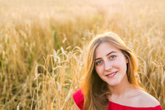 Bright Portrait of Happy Young Woman at Summer Field. Bright Portrait of Happy Woman at Summer Field Stock Images