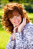 Bright portrait of red-haired young woman outdoors. Close-up bright portrait of red-haired lovely young woman outdoors Stock Photo