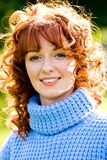 Bright portrait of red-haired young woman outdoors Stock Photo