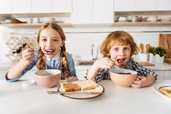 Free Bright Positive Children Enjoying Tasty Chocolate Flavored Breakfast Stock Photos - 86424443