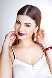 Bright positive fashion studio portrait of pretty young girl with purple lips, bright make up, body, stylish trendy outfit: b Stock Image
