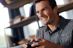 Bright positive man passionate about gaming Stock Photos