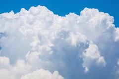 Bright puffy cloud. Bright white puffy cloud on the blue sky stock photos