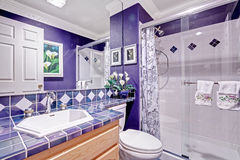 Bright purple bathroom interior Stock Photo