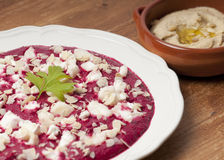 Bright purple beetroot puree with goat's cheese Stock Images