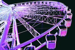 Bright purple lights go round. Purple lit ferris wheel at Centennial Park in downtown Atlanta Georgia Stock Images