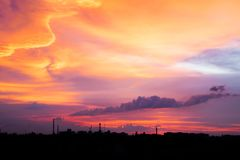 Bright purple, pink, lilac and orange sunset over city. City ind royalty free stock photos