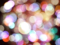 Bright purple and white blurred round glowing lights on black abstract background royalty free stock photography