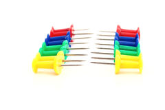 Bright push pins in a double row Stock Images