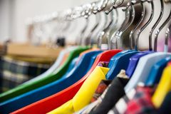 Racks with hanging clothes. Royalty Free Stock Photo