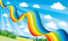 Bright rainbow in the blue sky. Bright rainbow in the blue sky over the summer landscape Stock Photos