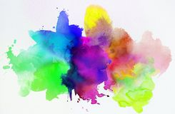 Rainbow colored watercolor paints and textures on white paper Stock Photography