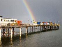Bright Rainbow at the End of Teignmouth Pier. After a heavy shower a bright rainbow appears at the end of the historic Teignmouth Pier  Devon, England Stock Images