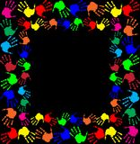 Multicolored handprints border on black  background. Bright rainbow frame with empty copy space for text or image and multicolored handprints double border Stock Images