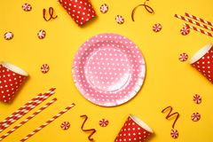 Bright rainbow lollipop candy on colorful yellow wood table for royalty free stock images