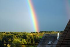 Bright rainbow. Over rural landscape with fields and forest Stock Image