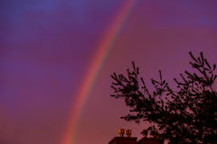 A bright rainbow in the sky. Rainbow in the sky during the sunset Stock Photos
