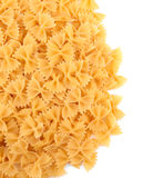 Bright and raw yellow macaroni, isolated on a white background. Noodle, macarons, pasta, spagheti. royalty free stock images