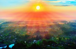 Bright rays of dawn over the suburbs, top view. Bright rays of dawn over the suburb, the view from the top Stock Photos