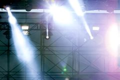 bright rays of professional stage spotlights during street concert stock images